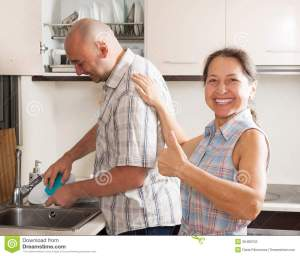 woman-man-washing-dishes-housewife-kitchen-her-husband-plates-36489752